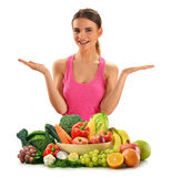 Woman with basket full of vegetables and fruits Stock Photography