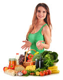 Woman with basket full of vegetables and fruits Stock Photo