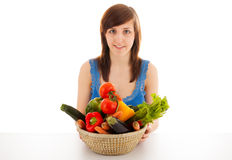 A woman with a basket full of vegetables Royalty Free Stock Image