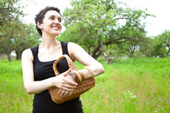 Woman with basket in the garden Stock Photos