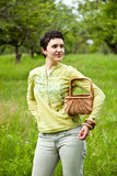 Woman with basket in the garden Royalty Free Stock Photo