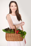 Woman with basket Stock Images