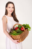 Woman with basket Royalty Free Stock Image