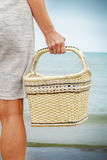 Woman with basket near sea Royalty Free Stock Photography