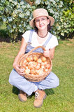 Woman with basket of onions Royalty Free Stock Photography