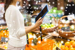 Woman with basket and tablet pc in market Stock Photos
