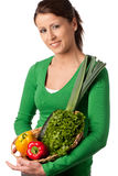 Woman with basket of vegetables Stock Photos
