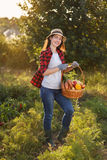 Woman with basket of vegetables Royalty Free Stock Images
