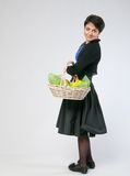 Woman with basket Stock Photo