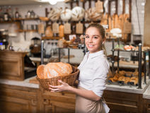 Woman with basket. Young girl with basket in bakery Stock Photo