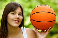 Woman with a basketball Royalty Free Stock Photo