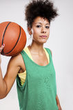 Woman with basketball Stock Photography