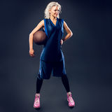 Woman basketballer in blue jersey Stock Photos