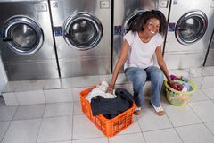 Woman With Baskets Of Dirty Clothes Sitting At Stock Photos