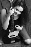 Woman with bass guitar, B&W Stock Photography