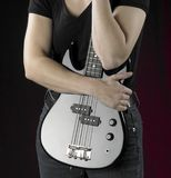 Woman with bass guitar Royalty Free Stock Image