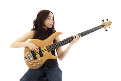 Woman with a bass guitar. Young woman playing a bass guitar (Series with the same model available stock photos