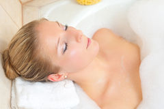 Woman in bath Stock Images