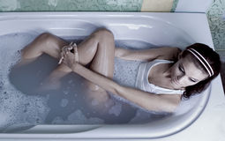 Woman in bath. Attractive young woman in bath Royalty Free Stock Image