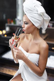 Woman after bath drinking champagne Royalty Free Stock Photography