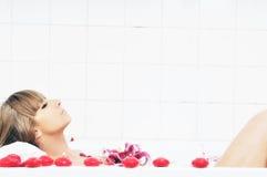 Woman bath flower royalty free stock photography
