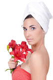 Woman after bath with flower Royalty Free Stock Photos