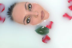 Woman in a bath with flowers Stock Photos