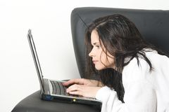Woman after bath with laptop Royalty Free Stock Photography