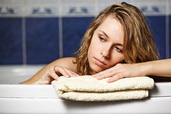 woman in the bath laying on the towel Stock Photos