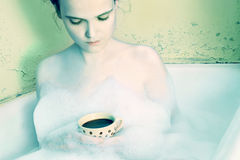 Woman in bath. Relaxed with coffee Royalty Free Stock Image