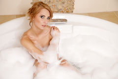Woman in bath relaxing. Closeup of young woman in bathtub bathin Royalty Free Stock Image