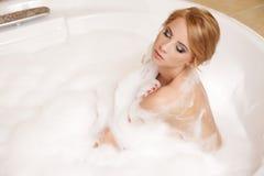 Woman in bath relaxing. Closeup of young woman in bathtub bathin Stock Photo