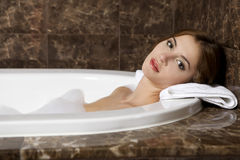 Woman in bath relaxing. Closeup of young woman in bathtub bathin Stock Image