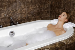Woman in bath relaxing. Closeup of young woman in bathtub bathin Stock Photos