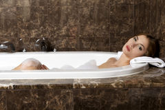 Woman in bath relaxing. Closeup of young woman in bathtub bathin Stock Images