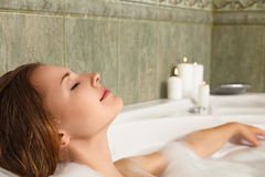 Woman in bath relaxing. Young beautiful woman relaxing in a bath Royalty Free Stock Image