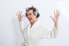 Woman in Bath Robe Standing with Open Arms Stock Photo