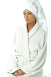 Woman with bath robe and towel Royalty Free Stock Photography