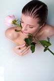 Woman in bath with rose Royalty Free Stock Photo