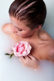 Woman in bath with rose. Beauty woman in bath with rose in milk water royalty free stock photography