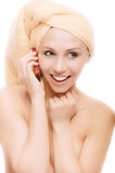Woman after bath speaks on phone Royalty Free Stock Images