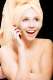 Woman after bath speaks on phone Royalty Free Stock Image