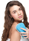 Woman with bath sponge Stock Images