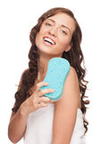 Woman with bath sponge Stock Photo