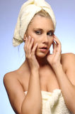 Woman in the bath towel. On blue-gray background Stock Photo