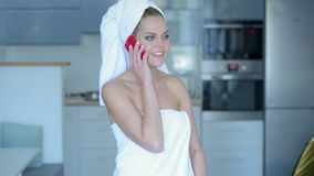 Woman in Bath Towel Talking on Cell Phone Royalty Free Stock Photo