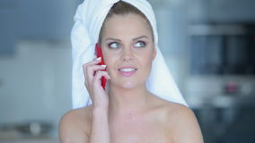 Woman in Bath Towel Talking on Cell Phone Royalty Free Stock Photography