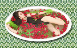 Woman in a Bath Tub Full of Flowers Royalty Free Stock Photography