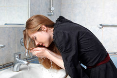 Woman in bath wash up face Royalty Free Stock Photo