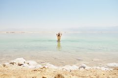 Woman bathe at the Dead Sea. Young woman bathe at the Dead Sea, Israel Stock Photo
